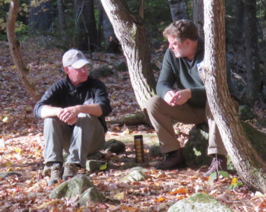 2 Men in the woods discussing